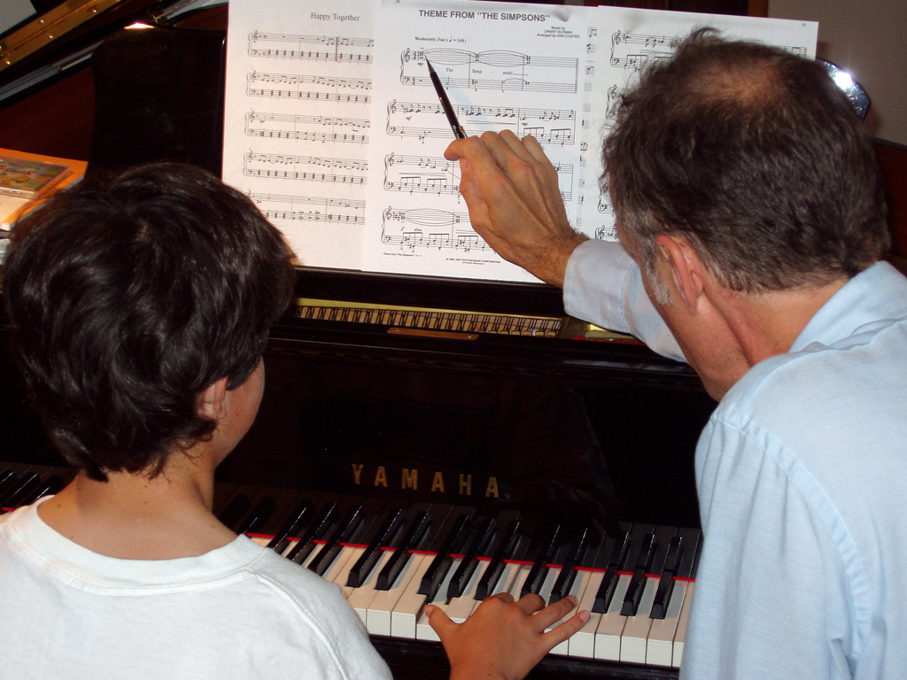 [Image: Teaching Piano]